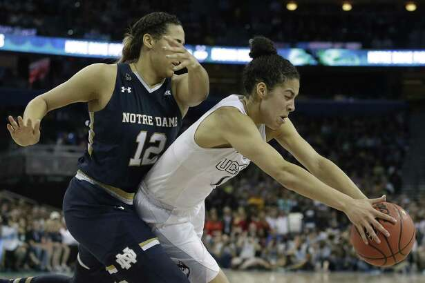 Connecticut guard Kia Nurse (11) and Notre Dame forward Taya Reimer (12) chase a loose ball during the second half of the NCAA women's Final Four tournament college basketball championship game, Tuesday, April 7, 2015, in Tampa, Fla. Connecticut won 63-53. (AP Photo/Brynn Anderson)