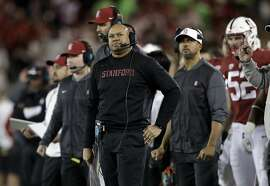 FILE - In this Saturday, Nov. 18, 2017, file photo, Stanford head coach David Shaw watches during the first half of an NCAA college football game against California in Stanford, Calif. No. 20 Stanford may have some divided attention when the Cardinal take on No. 9 Notre Dame. Stanford can win the Pac-12 North and earn a spot in the conference title game if Washington beats Washington State in the Apple Cup taking place at the same time.  (AP Photo/Marcio Jose Sanchez, File)