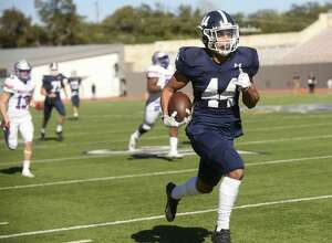 Trevon Moehrig-Woodard of the Smithson Valley Rangers runs for a 70-yard first-quarter touchdown during Class 6A Division II second-round high school football playoff action against Austin Westlake at Alamo Stadium on Friday, Nov. 24 2017.
