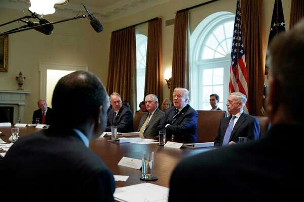 "FILE - In this Oct. 16, 2017, file photo President Donald Trump speaks during a cabinet meeting at the White House in Washington, with from left, Director of National Intelligence Dan Coats, Interior Secretary Ryan Zinke, Secretary of State Rex Tillerson, and Defense Secretary Jim Mattis. The White House has already begun work on one of Trump's next priorities: welfare reform. He said changes were ""desperately needed in our country"" and that his administration would soon offer plans. In October, Trump said at a Cabinet meeting that welfare reform was ""becoming a very, very big subject, and people are taking advantage of the system."" (AP Photo/Evan Vucci)"