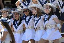 Members of the Smithson Valley Silver Spurs dance team sing in the stands during Class 6A Division II second-round high school football playoff action against Austin Westlake at Alamo Stadium on Friday, Nov. 24 2017.