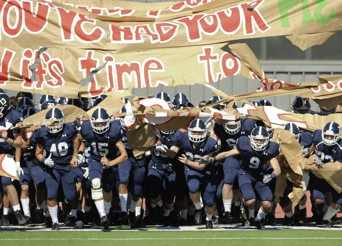The Smithson Valley Rangers enter the Alamo Stadium field for their Class 6A Division II second-round high school football playoff game against Austin Westlake on Friday, Nov. 24 2017.