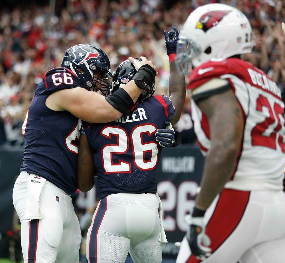Texans running back Lamar Miller (26) celebrates a touchdown with center Nick Martin (66) last Sunday. Martin has emerged as a pivotal figure in the offense. Photo: \052011000683\, Staff / © 2017 Houston Chronicle