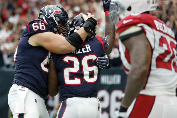 Texans running back Lamar Miller (26) celebrates a touchdown with center Nick Martin (66) last Sunday. Martin has emerged as a pivotal figure in the offense.