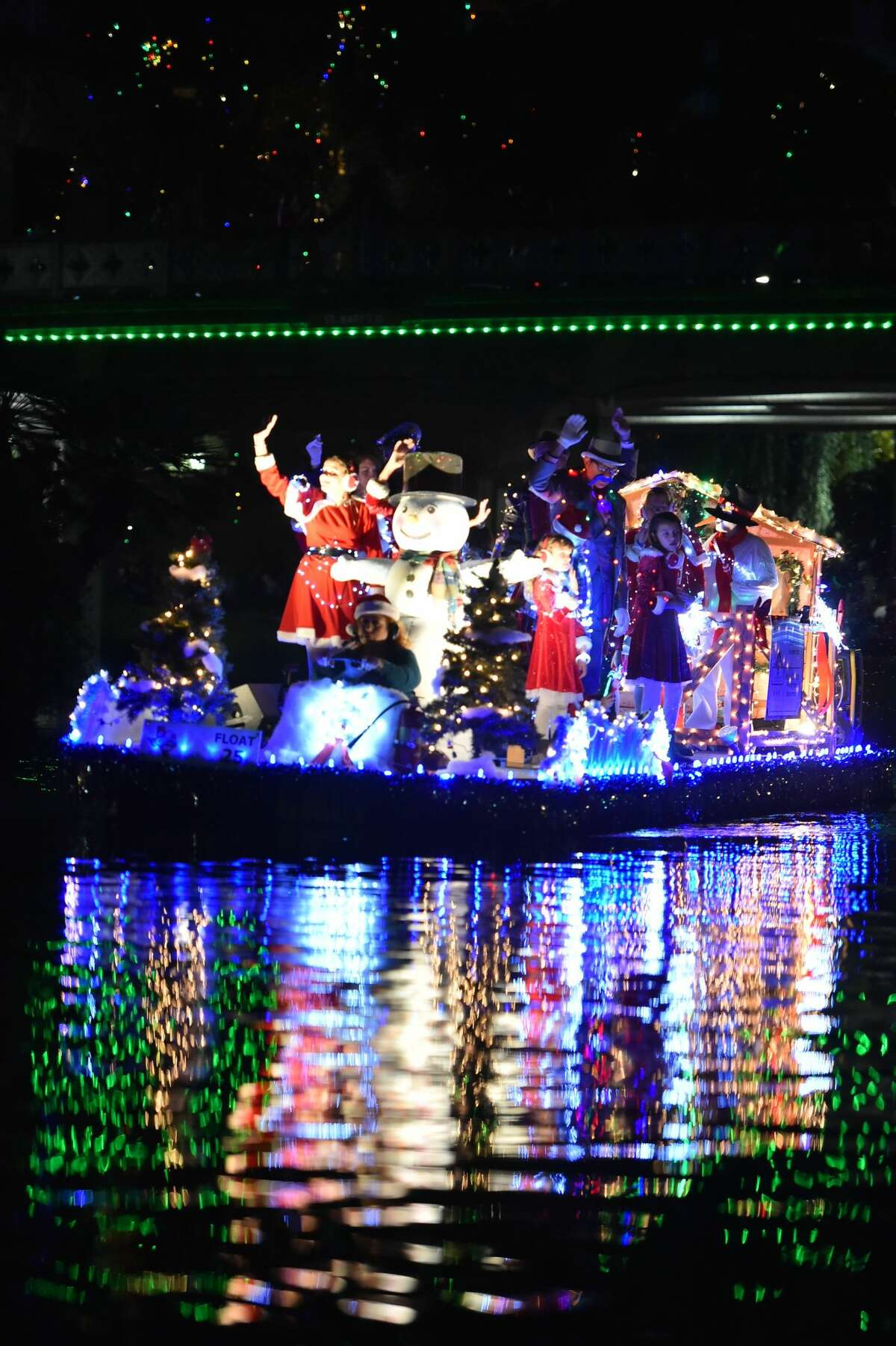 Floats cruise down the river during the 37th Annual Ford Holiday River Parade Friday evening. The parade features 28 illuminated floats decorated for the theme Christmas at the Movies?