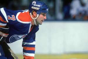 APRIL - 1986:  Defenseman Paul Coffey of the Edmonton Oilers looks on as he prepares for a face-off during a game in April of 1986.  Paul Coffey played for the Oilers from 1980 - 1987. (Photo by Bruce Bennett Studios/Getty Images)