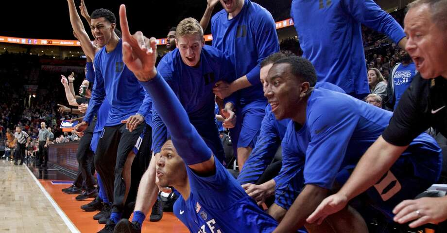 The Duke bench reacts after guard Trevon Duval, bottom, scored after being fouled during the second half of an NCAA college basketball game against Texas in the Phil Knight Invitational tournament in Portland, Ore., Friday, Nov. 24, 2017. (AP Photo/Craig Mitchelldyer) Photo: Craig Mitchelldyer/Associated Press