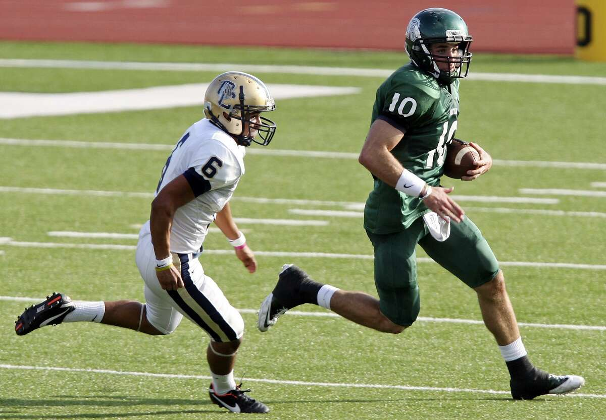 FOR SPORTS - Reagan's Trevor Knight looks for running room around O'Connor's Stephen Cantu during first half action of their Class 5A Division II playoff game Saturday Nov. 19, 2011 at Heroes Stadium. (PHOTO BY EDWARD A. ORNELAS/eaornelas@express-news.net)