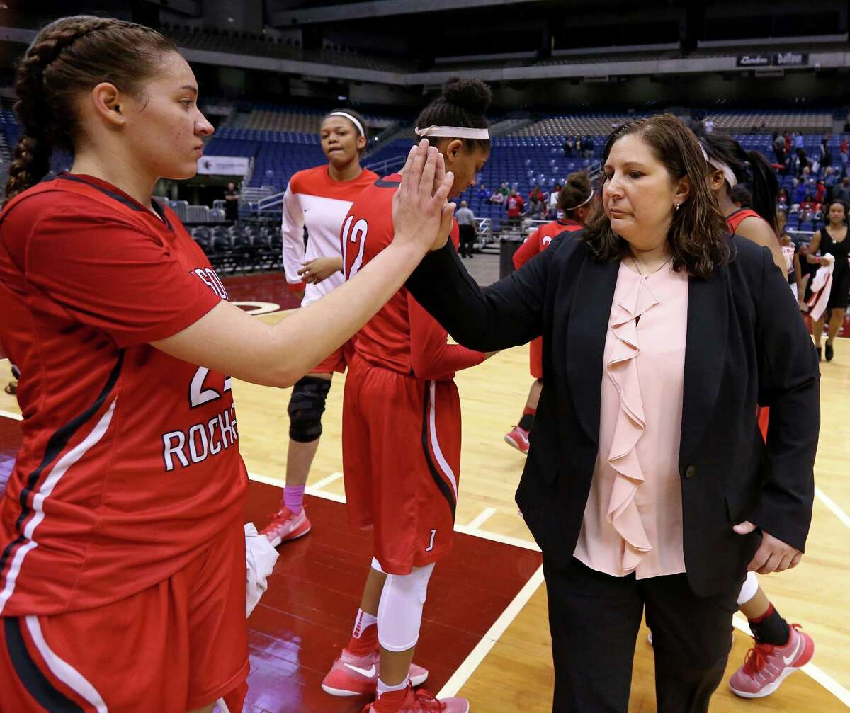 Judson's Kyra White and head coach Triva Corrales high five after their Class 6A state semifinal game against Duncanville held Friday March 3, 2017 at the Alamodome. Duncanville won 53-41.