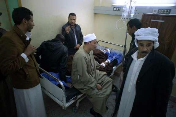 Relatives visit Sheikh Sulieman Ghanem, 75, center, at Suez Canal University Hospital in Ismailia, Egypt.