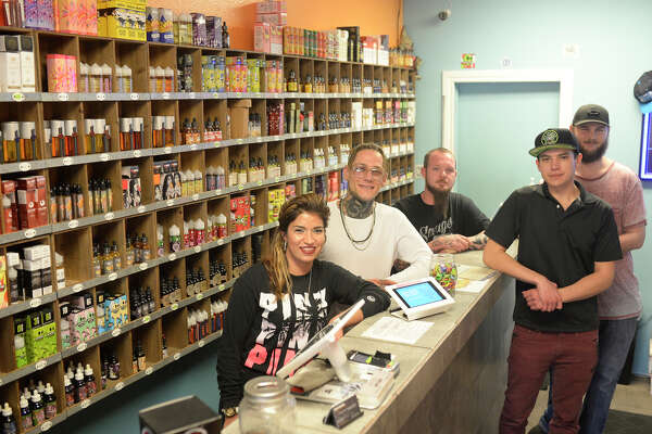 From left, Cloud City Vape Shop co-owners Amber Delarosa and Sam Stevenson with employees CJ Johnson, Julius Ruiz, and Jamie Bright photographed Nov. 24, 2017. James Durbin/Reporter-Telegram