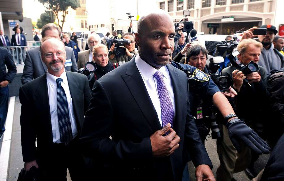 Former baseball player Barry Bonds leaves federal court Wednesday, April 13, 2011, in San Francisco, after being found guilty of one count of obstruction of justice. The jury failed to reach a verdict on three other counts that the home run king lied to a grand jury when he denied knowingly using steroids and human growth hormone. Photo: Noah Berger, ST
