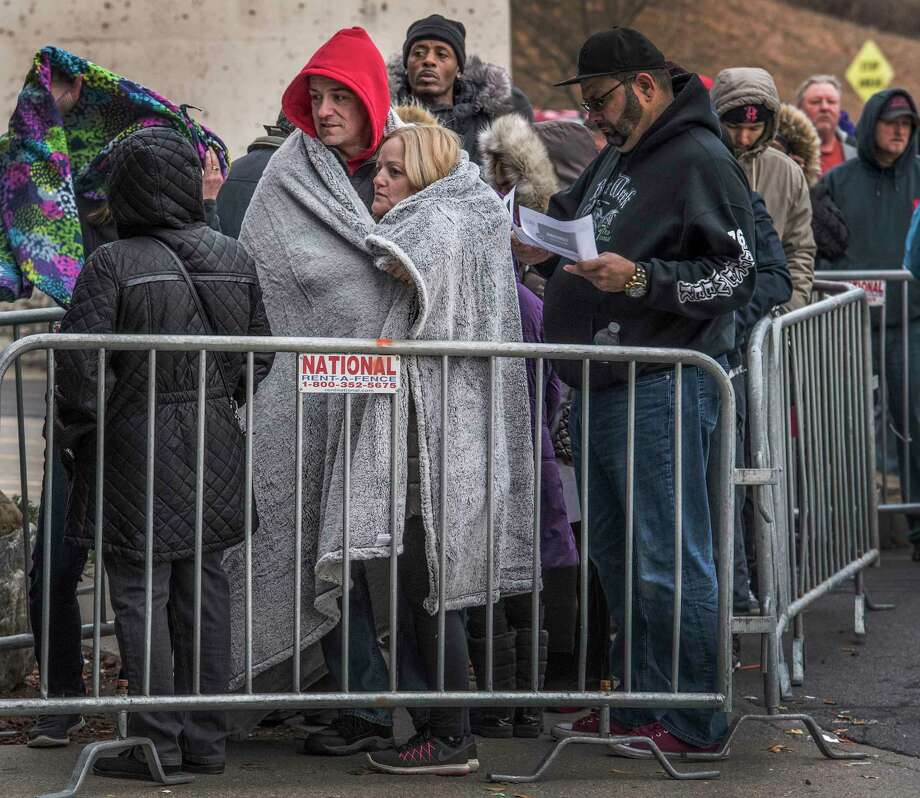 Remember when Black Friday actually began early on the Friday after Thanksgiving? Click through the slideshow of Black Friday shopping through the years. Todd and Nicole Ritchie huddle beneath a blanket as they wait a few hours in the chill of early morning for the Black Friday opening of Best Buy, Friday Nov. 24, 2017 in Albany, N.Y.    (Skip Dickstein/ Times Union) Photo: SKIP DICKSTEIN / 20042193A