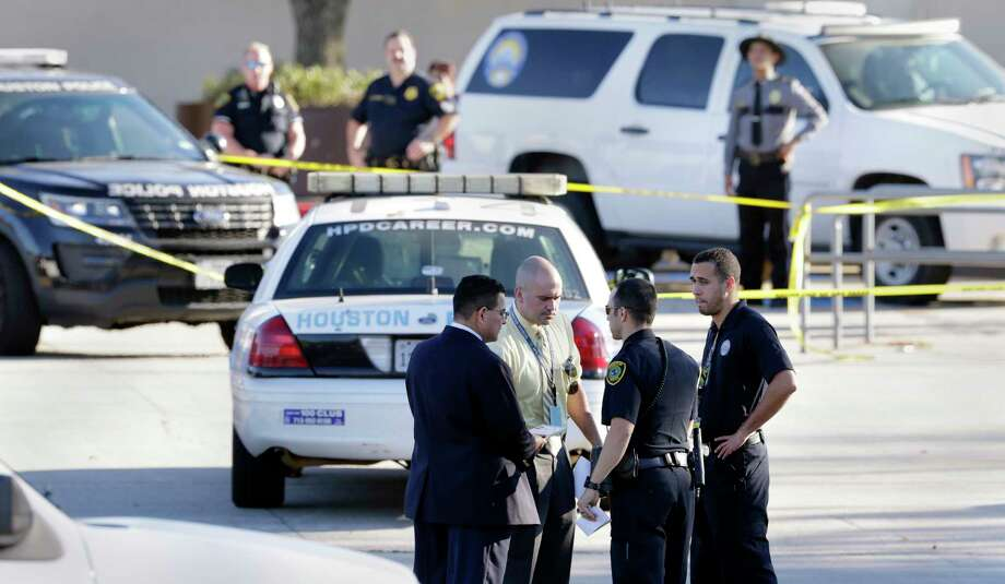 Police investigate the scene in the parking lot adjacent to the Sears store at Willowbrook Mall. The Black Friday altercation between two males turned violent and both were transported by air ambulance. Photo: Michael Wyke, Freelance / © 2017 Houston Chronicle