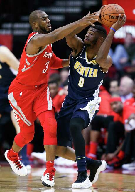 Chris Paul (3) applies pressure on Nuggets guard Emmanuel Mudiay during Wednesday night's 125-95 victory for the Rockets, who have held four of their last six opponents below 100 points. Photo: Eric Christian Smith, FRE / FR171023 AP