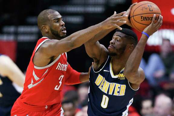 Chris Paul (3) applies pressure on Nuggets guard Emmanuel Mudiay during Wednesday night's 125-95 victory for the Rockets, who have held four of their last six opponents below 100 points.