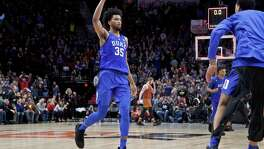 Duke forward Marvin Bagley III reacts at the end of overtime of an NCAA college basketball game against Texas in the Phil Knight Invitational tournament in Portland, Ore., Friday, Nov. 24, 2017. Duke won 85-78. (AP Photo/Craig Mitchelldyer)