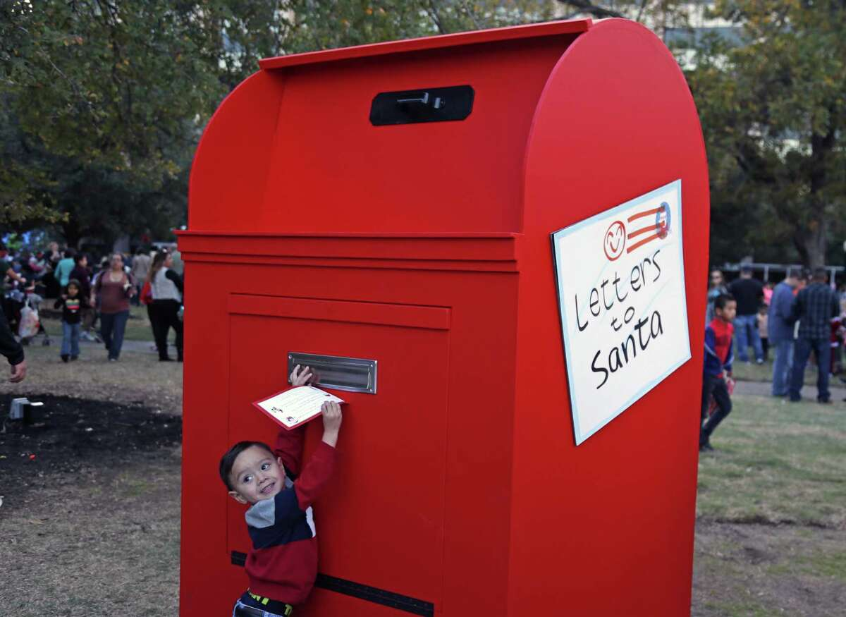 A child mails a letter to Santa at Travis Park on Nov. 24. A reader offers a message relevant to Christmas and New Year's.
