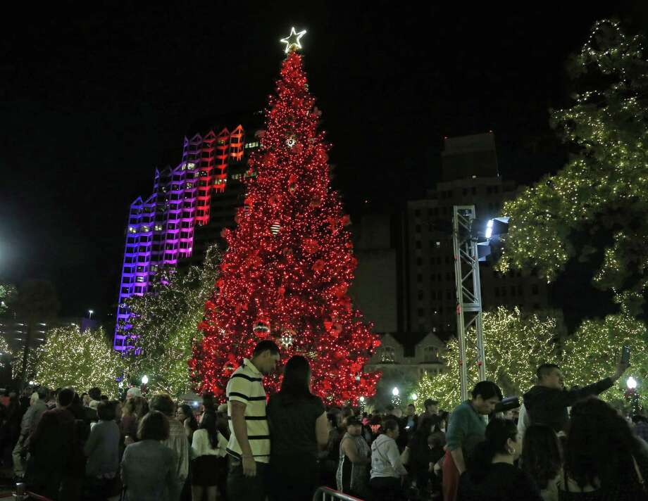 The holiday season kicked off at Travis Park with the lighting of the 55-foot white fir Christmas tree donated by H-E-B on Friday. A reader has a problem with the designation the tree received in a recent article. Photo: Ron Cortes /