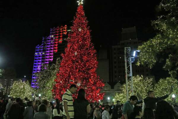 The holiday season kicked off at Travis Park with the lighting of a 55-foot white fir Christmas tree donated by H-E-B on Nov. 24.