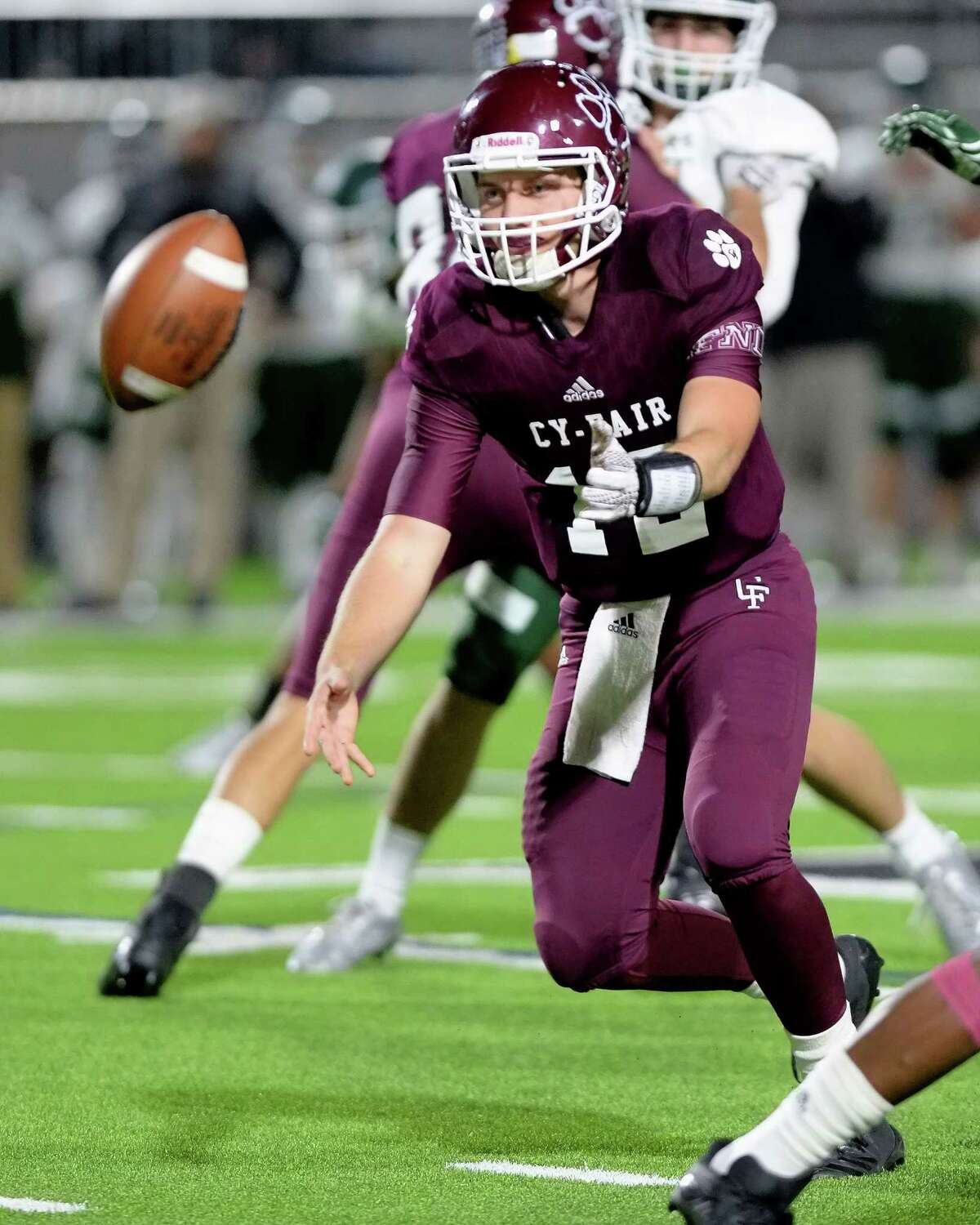Cam Arnold (12) of Cy-Fair pitches a ball in the fourth quarter of a 6A-III area playoff football game between the Cy-Fair Bobcats and the Strake Jesuit Crusaders on November 23, 2017 at Legacy Stadium, Katy, TX.