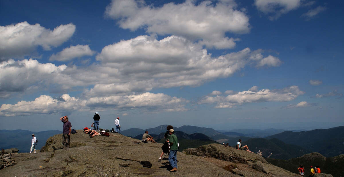 Hikers survey the scene on the summit of Mount Marcy, in Keene. Mount Marcy is the highest point in New York State, making it a very popular destination for hikers in the high peaks region of the Adirondack Park. (Paul Buckowski/Times Union)