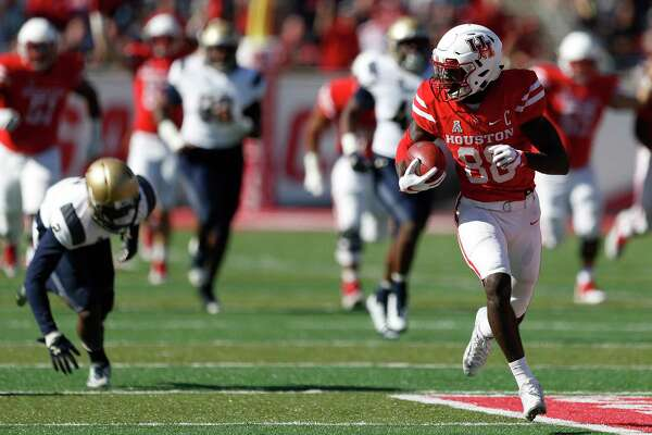 After breaking a tackle, UH receiver Steven Dunbar goes untouched the rest of the way on a 61-yard touchdown reception that gave the Cougars a 21-14 lead early in the fourth quarter Friday at TDECU Stadium.