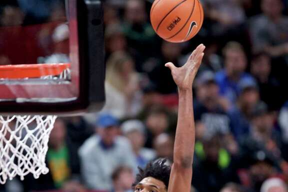 Duke forward Marvin Bagley III shoots over Texas forward Dylan Osetkowski to score two of his season-high 34 points in Friday's win at Portland, Ore.