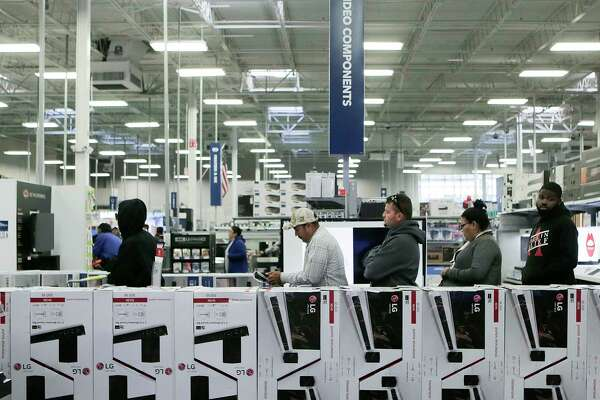 Shoppers line up to check out with their deals at the Best Buy on Richmond, near the Galleria. Some Black Friday shoppers were replacing items they lost in Harvey.