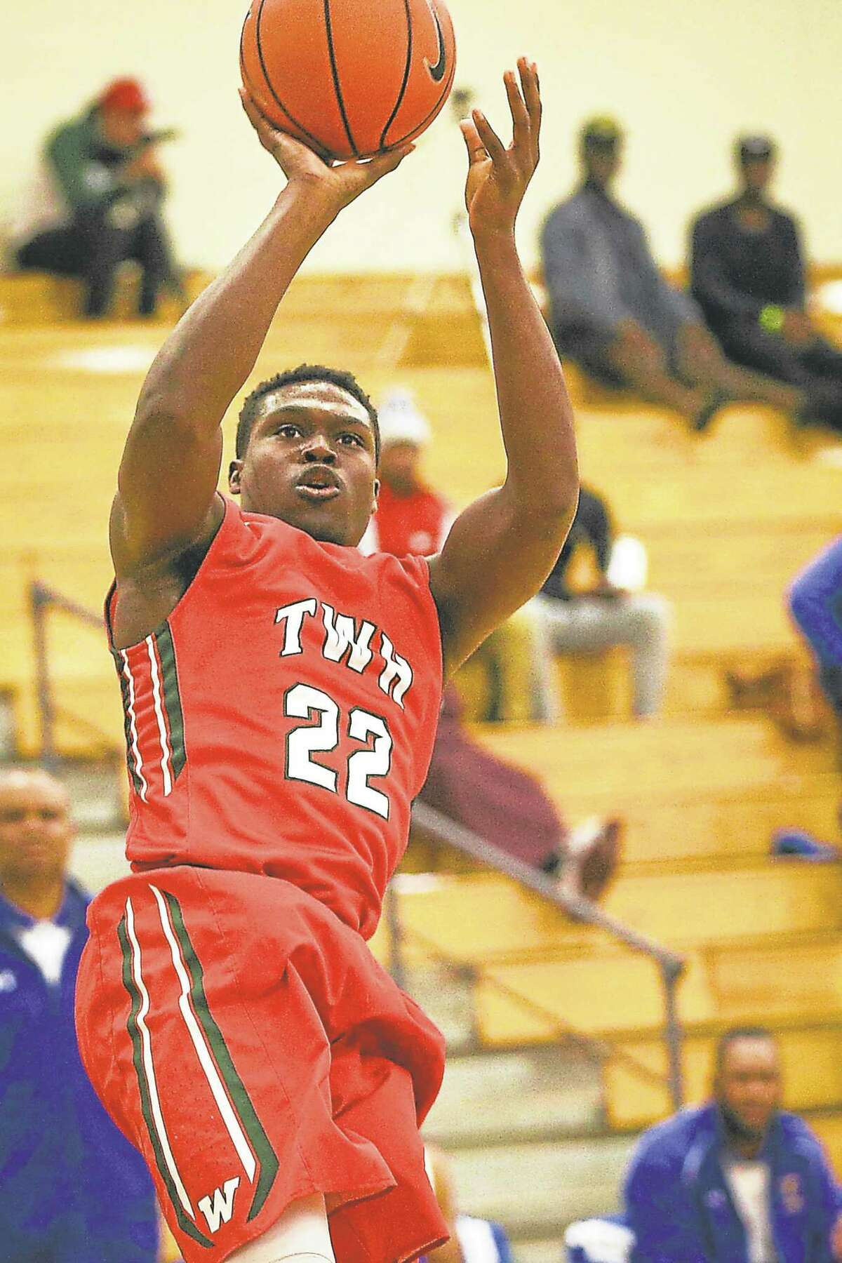 The Woodlands' Romello Wilbert (22) shoots the ball during the high school boys basketball game against Fort Bend Elkins on Saturday, Nov. 28, 2015, at The Woodlands High School. To view more photos from the game, go to HCNPics.com.