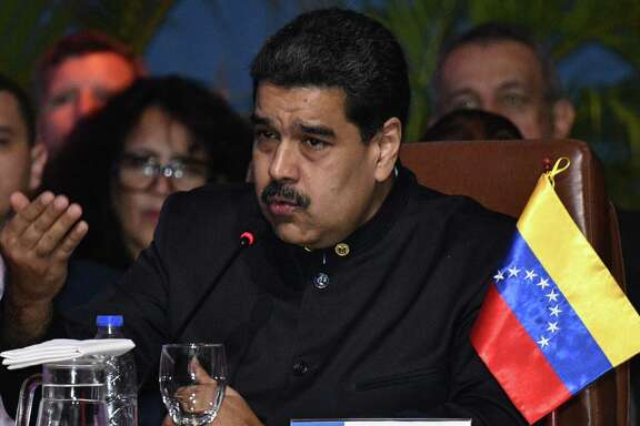 Venezuelan President Nicolas Maduro speaks during the IV Gas Exporting Countries Forum (GECF) Summit in Santa Cruz de la Sierra, Bolivia on November 24, 2017. / AFP PHOTO / AIZAR RALDESAIZAR RALDES/AFP/Getty Images
