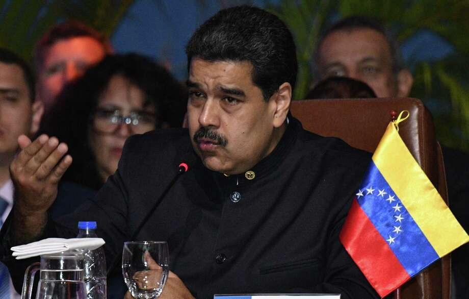 Venezuelan President Nicolas Maduro speaks during the IV Gas Exporting Countries Forum (GECF) Summit in Santa Cruz de la Sierra, Bolivia on November 24, 2017. / AFP PHOTO / AIZAR RALDESAIZAR RALDES/AFP/Getty Images Photo: AIZAR RALDES, Contributor / AFP or licensors