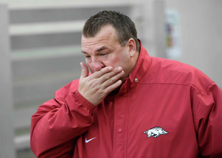Bret Bielema, who went 29-34 at Arkansas, fights tears as his seniors are introduced before Friday's loss. Photo: Michael Woods, FRE / Associated Press