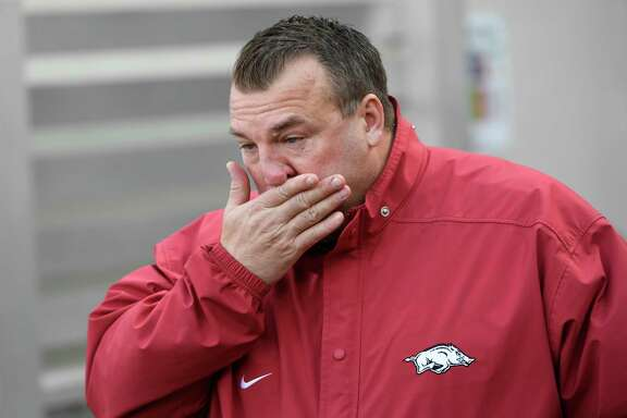 Bret Bielema, who went 29-34 at Arkansas, fights tears as his seniors are introduced before Friday's loss.