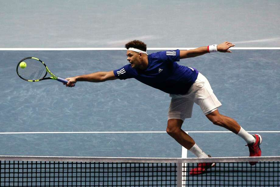 France's Jo-Wilfried Tsonga stretches to return the ball to Belgium's Steve Darcis during their Davis Cup singles match at Lille, France. Tsonga won 6-3, 6-2, 6-1 to even the finals after the first day of competition. Photo: Michel Spingler, STR / Copyright 2017 The Associated Press. All rights reserved.
