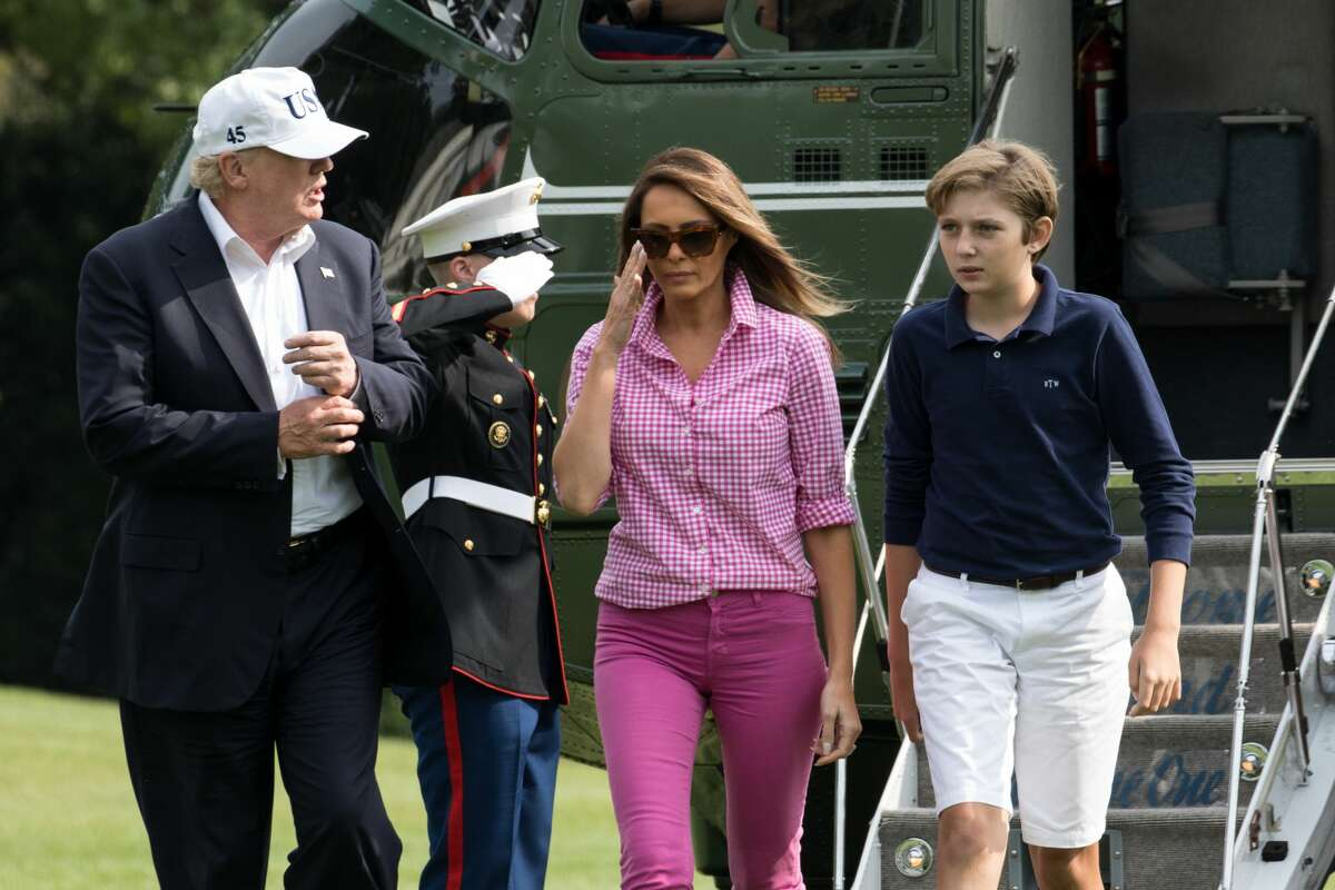 A Marine salutes, as he stands outside of Marine One, as President Donald Trump, followed by First Lady Melania Trump, and their 11-year-old son Barron, walk across the South Lawn, after The First Family returned to the White House from a weekend at Camp David, on Sunday, August 27, 2017. (Photo by Cheriss May) (Photo by Cheriss May/NurPhoto via Getty Images)