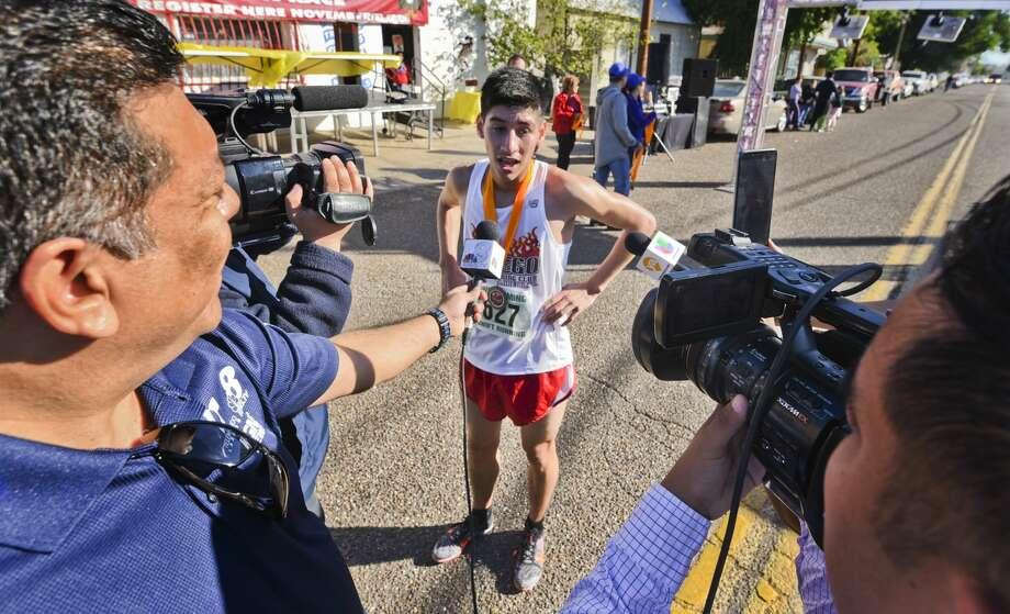Marlon Amador speaks to the media after winning the 37th Annual Guajolote Run on Thursday. Photo: Danny Zaragoza/Laredo Morning Times