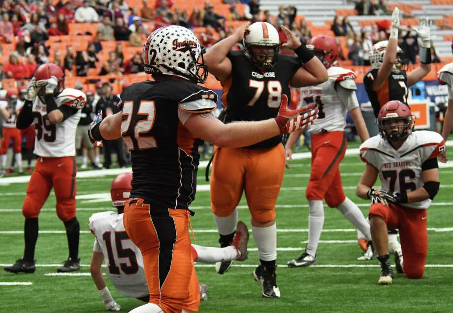 Cambridge running back Colton Dean (22) throws his arms up after scoring a touchdown during the Class D State football championship against Maple Grove on Friday, Nov. 24, 2017, at the Carrier Dome in Syracuse. Cambridge beat Maple Grove for the second year in a row for the state title 26-14. (Jenn March/Special to the Times Union) Photo: Jenn March / 20042201A