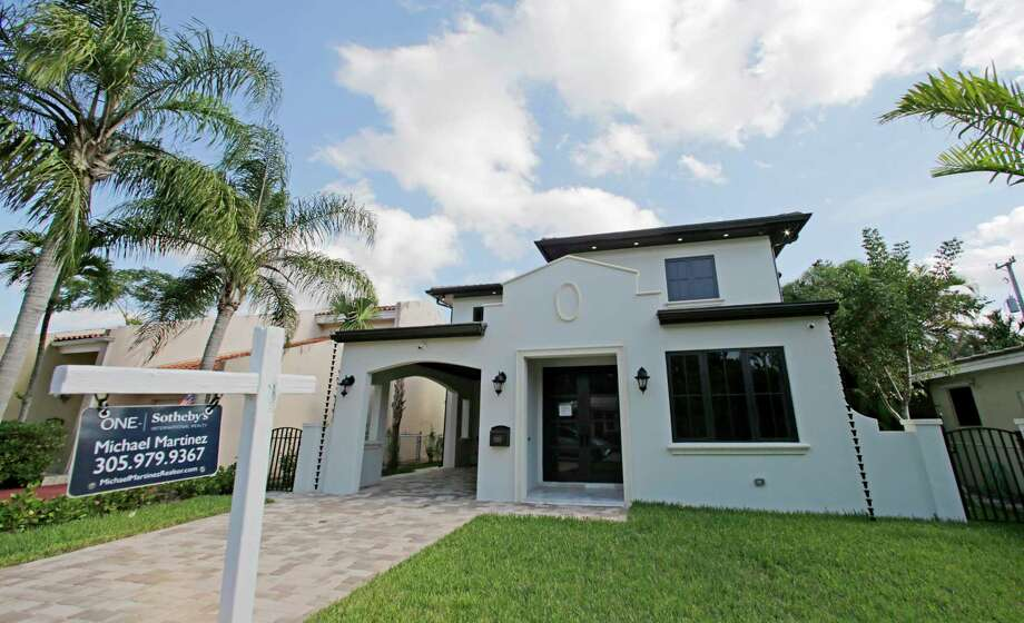 FILE - In this Dec. 6, 2016, file photo, a house is for sale in Coral Gables, Fla. On Tuesday, Nov. 21, 2017, the National Association of Realtors reports on sales of existing homes in October. (AP Photo/Alan Diaz, File) Photo: Alan Diaz, STF / Copyright 2016 The Associated Press. All rights reserved.