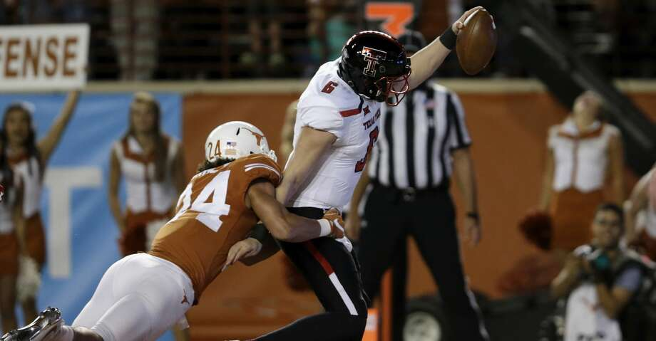 AUSTIN TX- NOVEMBER 24 Mc Lane Carter #6 of the Texas Tech Red Raiders rushes for a touchdown in the first quarter defended by John Bonney #24 of the Texas Longhorns at Darrell K Royal Texas Memorial Stadium