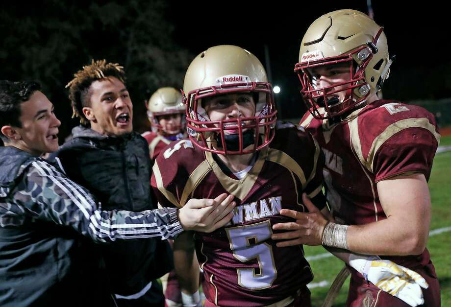 Cardinal Newman's Kyle Carinalli is congratulated after his game-winning touchdown reception late in 4th quarter of Newman's 29-28 win over Rancho Cotate in NCS Division 3 semifinal game in Santa Rosa, Calif., on Friday, November 24, 2017. Photo: Scott Strazzante, The Chronicle
