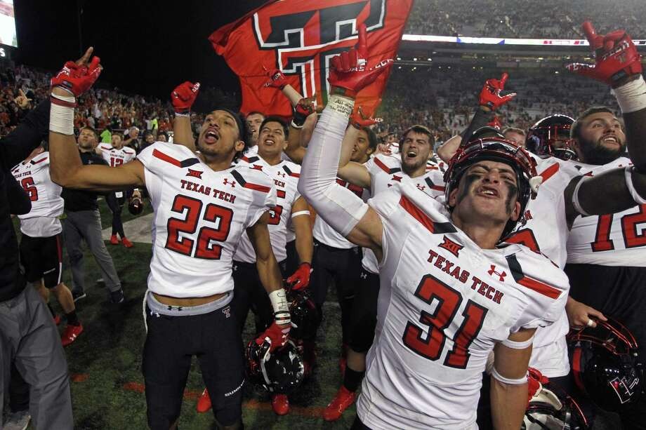Texas Tech's Da'Leon Ward (22) and Justus Parker (31) celebrate with their teammates after stunning Texas 27-23. Photo: Michael Thomas /Associated Press / FR65778 AP