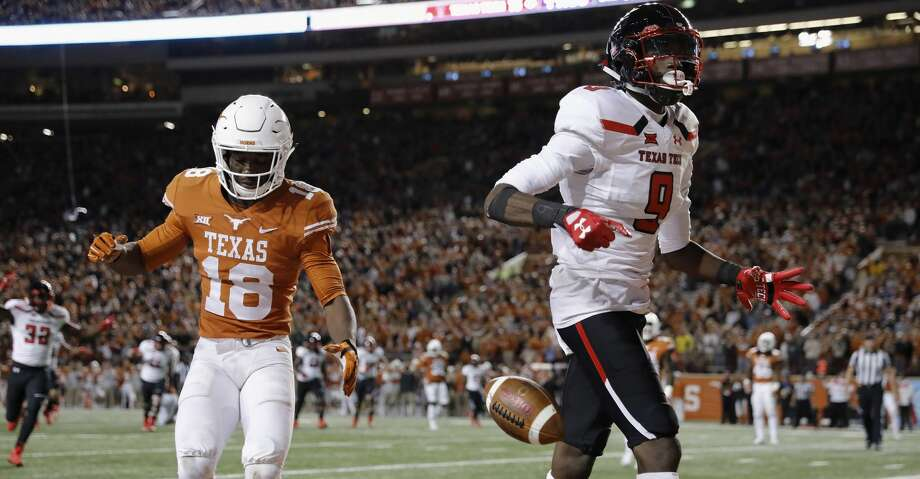 AUSTIN, TX - NOVEMBER 24:  T.J. Vasher #9 of the Texas Tech Red Raiders catches a pass for a touchdown defended by Davante Davis #18 of the Texas Longhorns in the fourth quarter at Darrell K Royal-Texas Memorial Stadium on November 24, 2017 in Austin, Texas.  (Photo by Tim Warner/Getty Images) Photo: Tim Warner/Getty Images