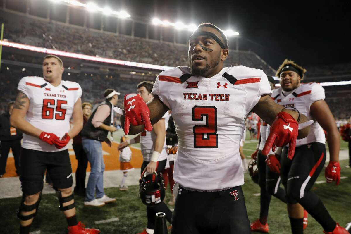 AUSTIN, TX - NOVEMBER 24: Keke Coutee #2 of the Texas Tech Red Raiders celebrates with teammates after the game against the Texas Longhorns at Darrell K Royal-Texas Memorial Stadium on November 24, 2017 in Austin, Texas. (Photo by Tim Warner/Getty Images)