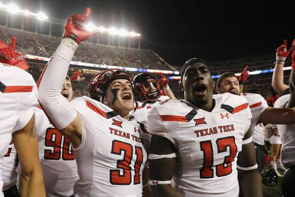 AUSTIN, TX - NOVEMBER 24:  Justus Parker #31 of the Texas Tech Red Raiders and Kolin Hill #13 celebrate after the game against the Texas Longhorns at Darrell K Royal-Texas Memorial Stadium on November 24, 2017 in Austin, Texas.  (Photo by Tim Warner/Getty Images)