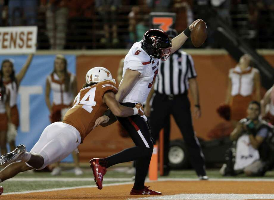 AUSTIN, TX - NOVEMBER 24:  McLane Carter #6 of the Texas Tech Red Raiders rushes for a touchdown in the first quarter defended by John Bonney #24 of the Texas Longhorns at Darrell K Royal-Texas Memorial Stadium on November 24, 2017 in Austin, Texas.  (Photo by Tim Warner/Getty Images) Photo: Tim Warner, Stringer / 2017 Getty Images
