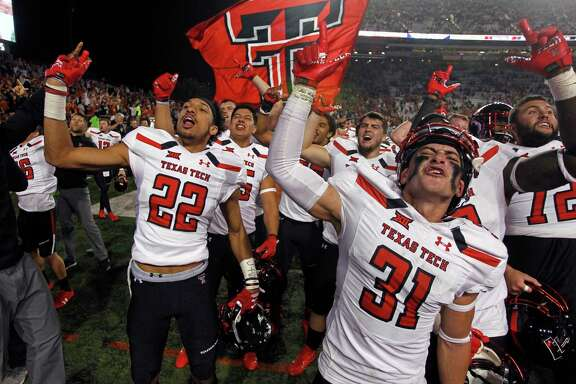 Texas Tech's Justus Parker (31), whose interception late in the fourth set up the winning touchdown, celebrates.