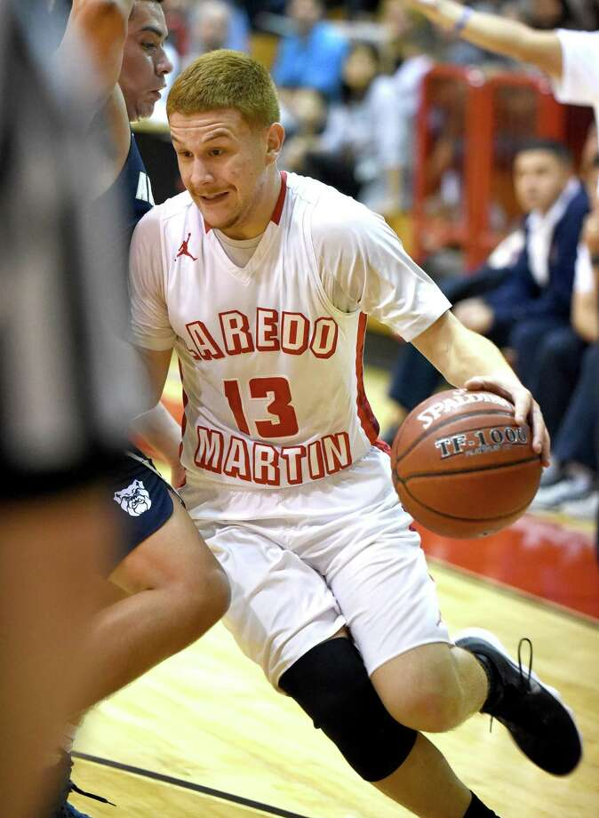 Luis Omar Ortegon hit eight 3-pointers and scored 40 points Friday in Martin's 70-66 win over Alexander. The Tigers advance to a noon matchup with United South in the Border Olympics semifinals. Photo: Danny Zaragoza /Laredo Morning Times / Laredo Morning Times