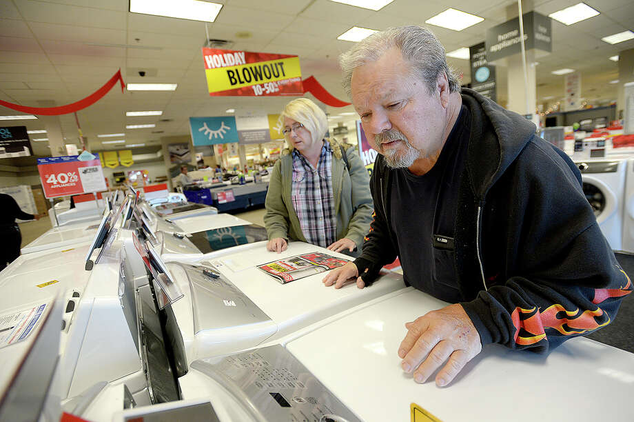 Cyndi and Randy Erwin of Lumberton check out the washer and dryers for sale as they shop for to replace items lost in Harvey's flooding on Black Friday at Sears. For many who lost everything in the flood, the holiday deals aren't just about shopping for deals on gifts or extras, but helping replace necessities. The Erwins lost everything in their home of 20 years located off Keith Road.  Photo taken Friday, November 24, 2017 Kim Brent/The Enterprise Photo: Kim Brent / BEN