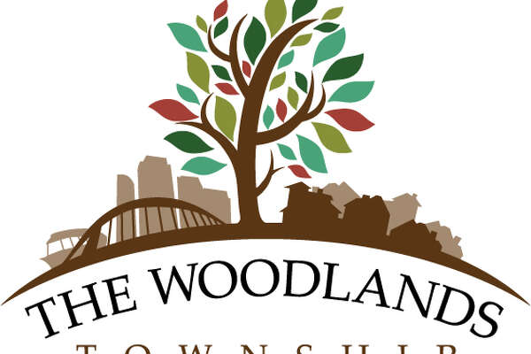 The Woodlands Township recently adopted a new logo to represent its expansion to a community-wide special district. The logo includes a single large tree in the center, with businesses on one side and homes on the other. The logo also features the Lake Robbins Bridge and The Woodlands Waterway Taxi. It was designed by Woodlands resident and artist Jeff Peterson.